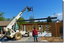 Placing the steel beam for the garage