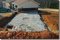 Garage wing with footers and post foundations poured