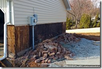 All the brick removed from the garage wing end of the house