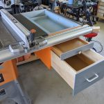 Table saw under-wing storage with pull-out shelf